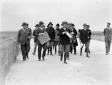 Mussolini accompagnato da Teruzzi e altre autorità ...